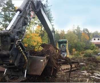 Markarbete med grävmaskin i Stockholm