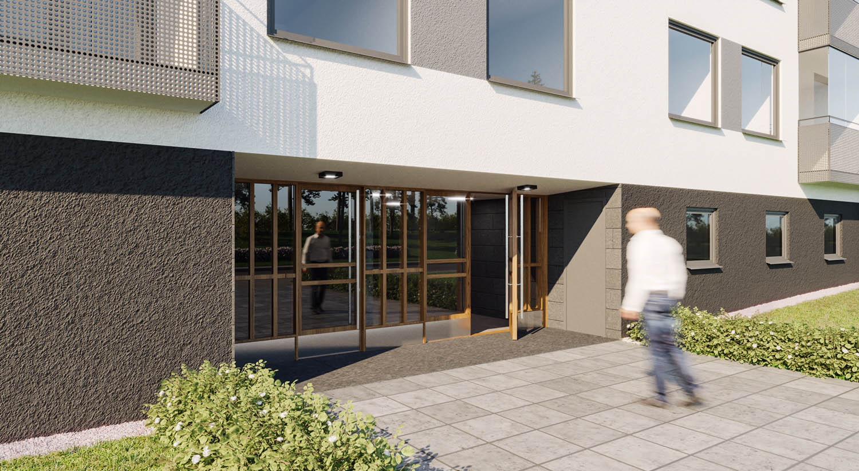 Man går mot ett nytt entréparti som byggts som en del i energieffektiviseringen av fastigheten i Södertälje, Stockholms län.