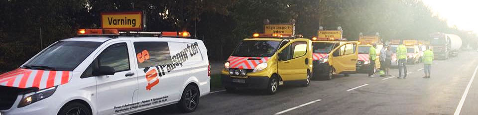 Varningsbil med följebilar